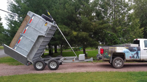 Just In Time Yard Services' dump trailer is put to work on rainy days.