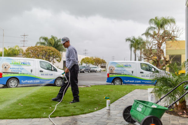 image of lawn care provider using invoicing scheduling and software