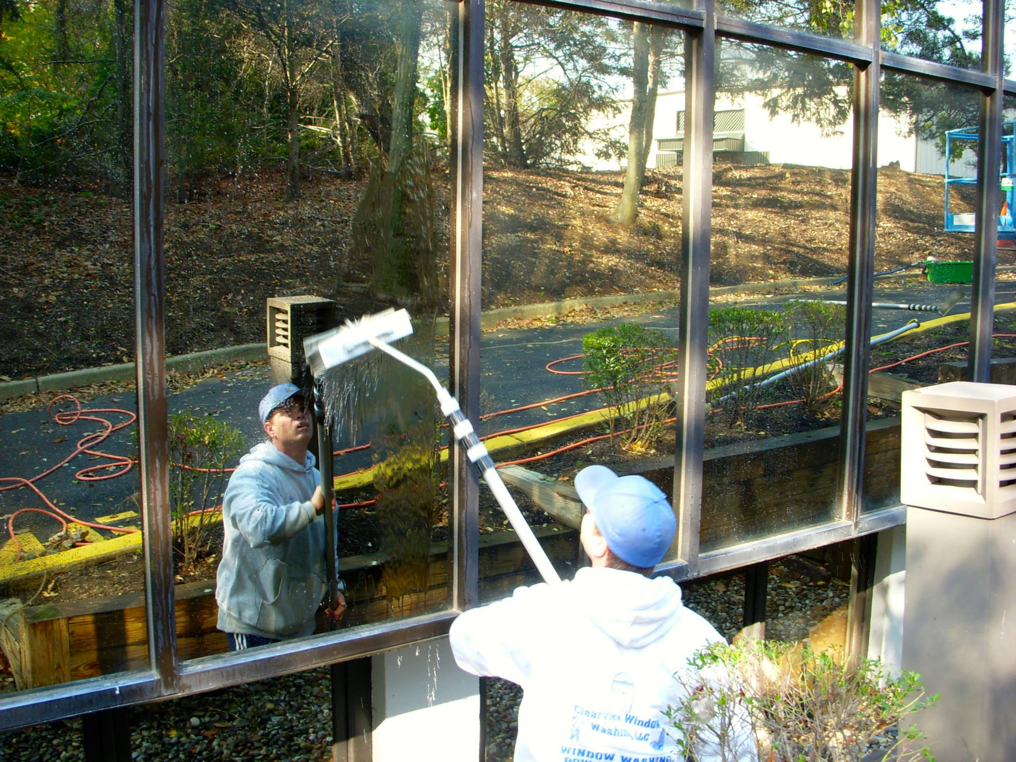 Window cleaner with squeegee getting more window cleaning contracts