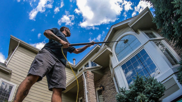Best window cleaning supplies: Professional window cleaner with a water fed pole