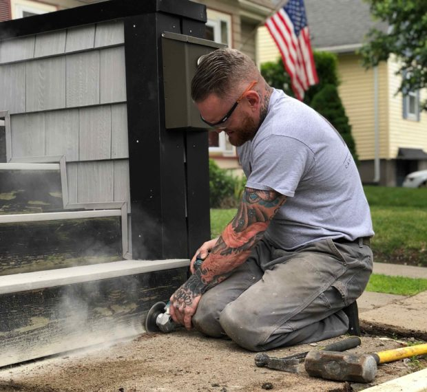 Image of carpenter using field service software
