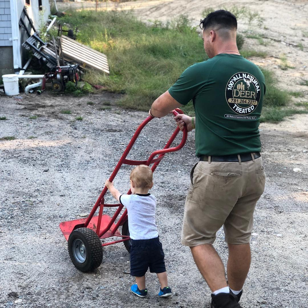 Image of pest control business owner and son