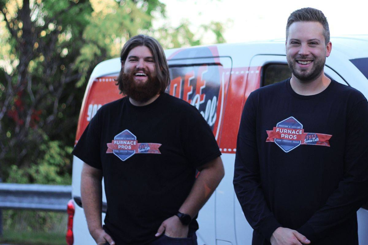 HVAC team standing in front of a truck