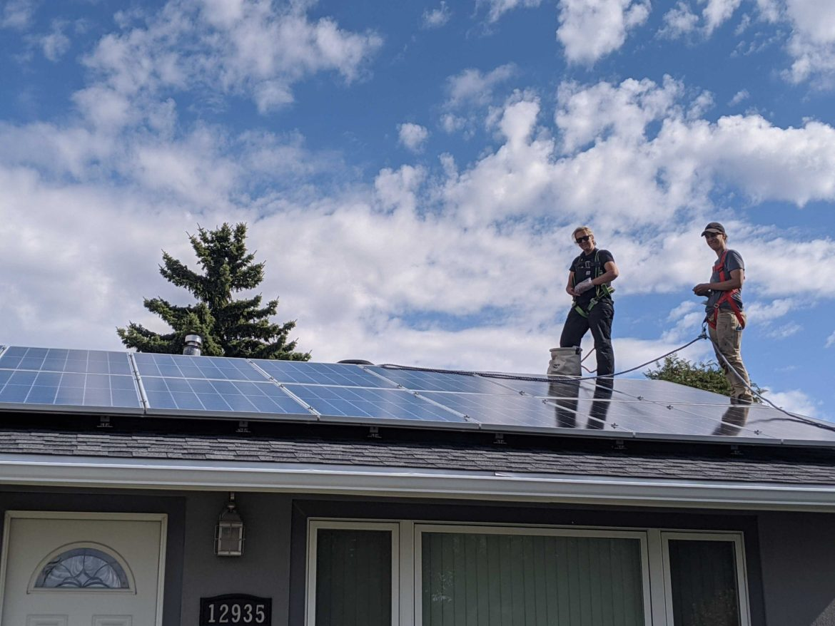 Professional Electricians from Kite Electric Company Standing on Roof
