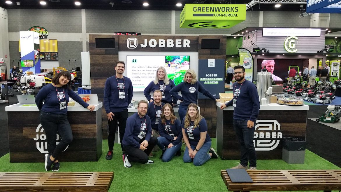 Jobber employees at trade show booth